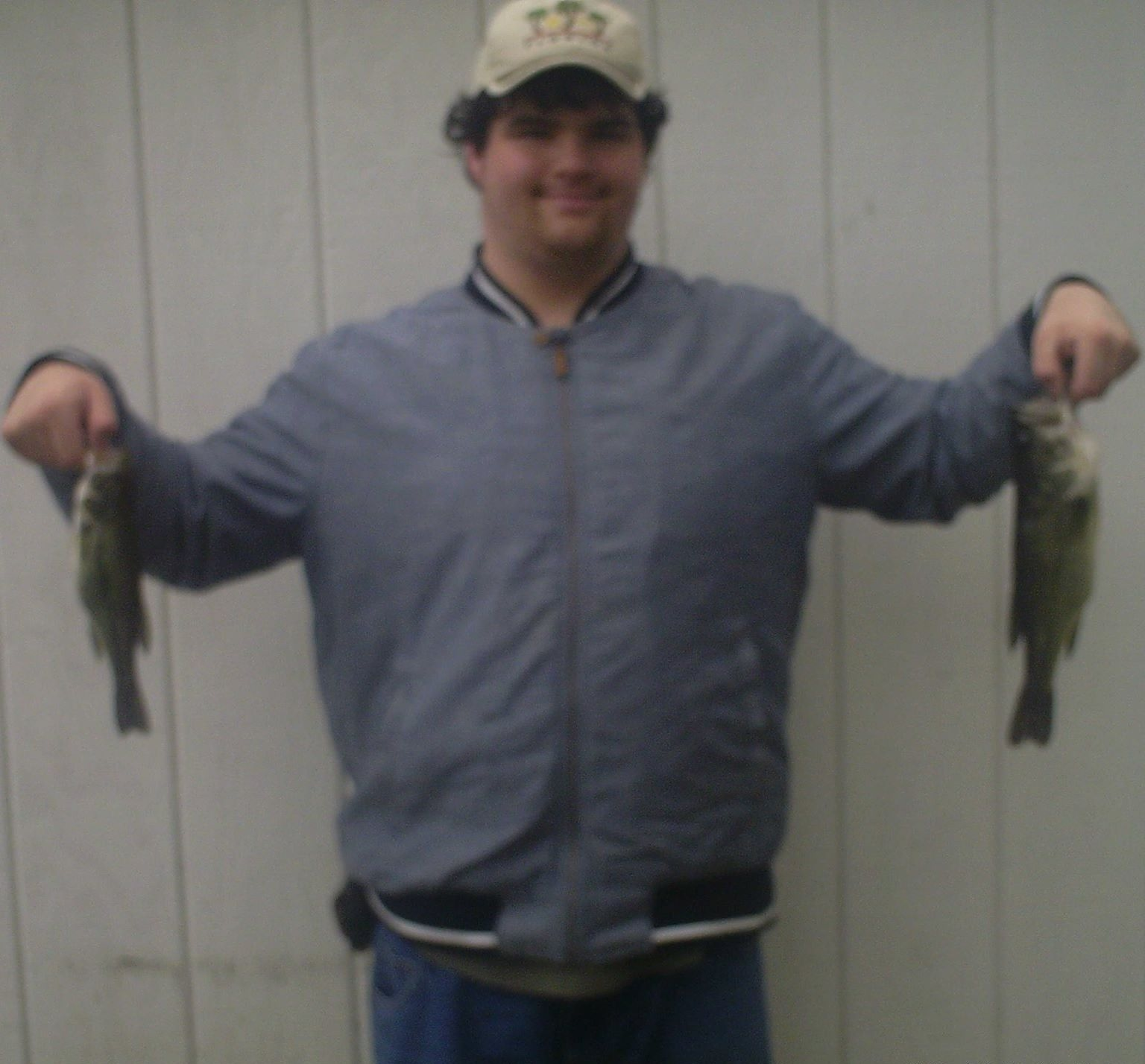 David Moore holding two largemouth bass.