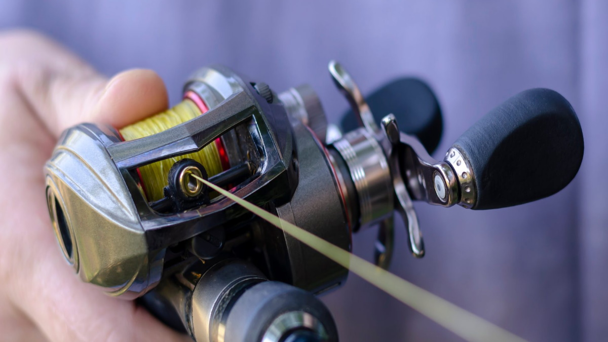 A baitcasting rod with extra line coming off.