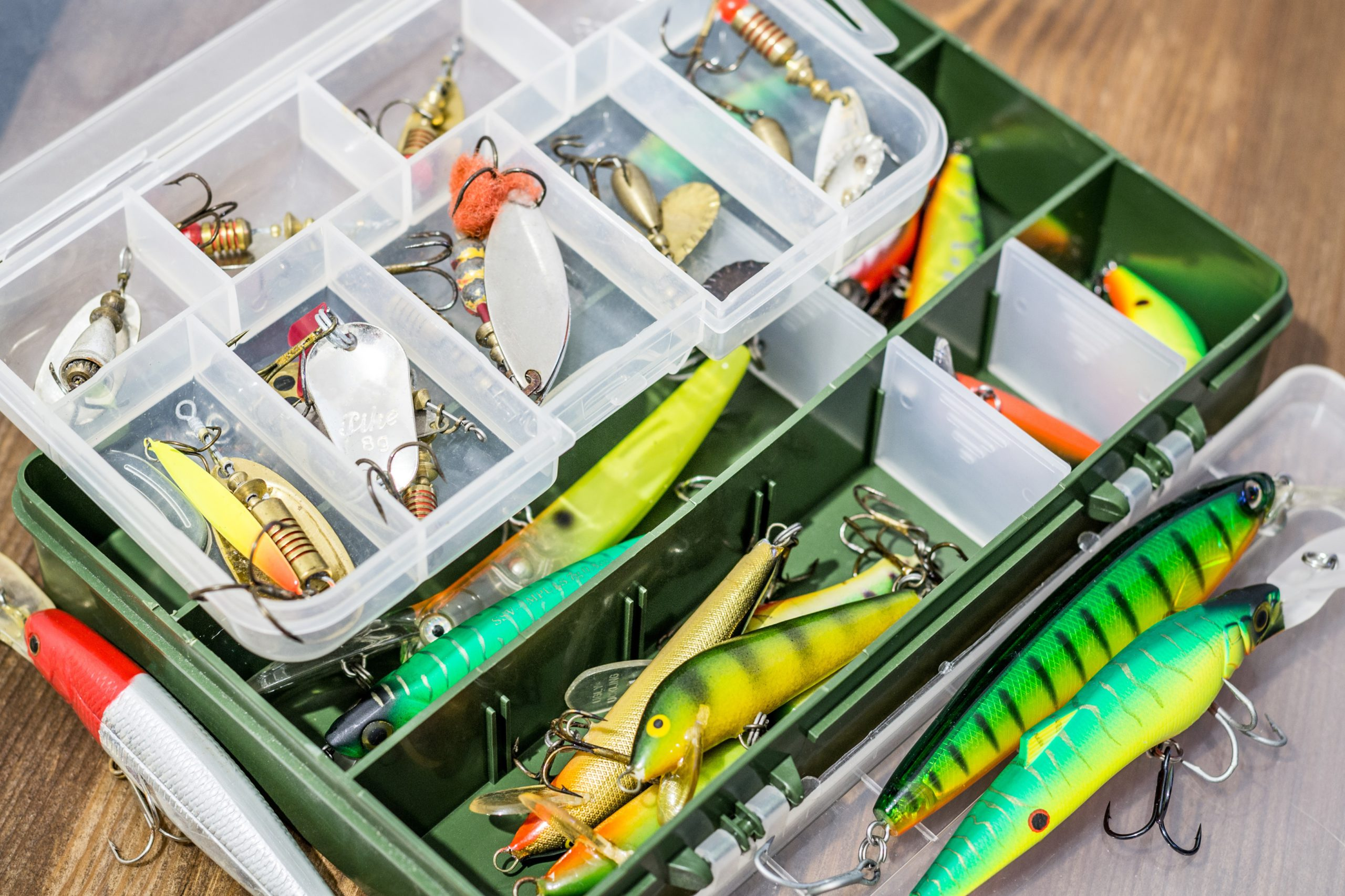 Tackle box loaded with different lures and hooks.