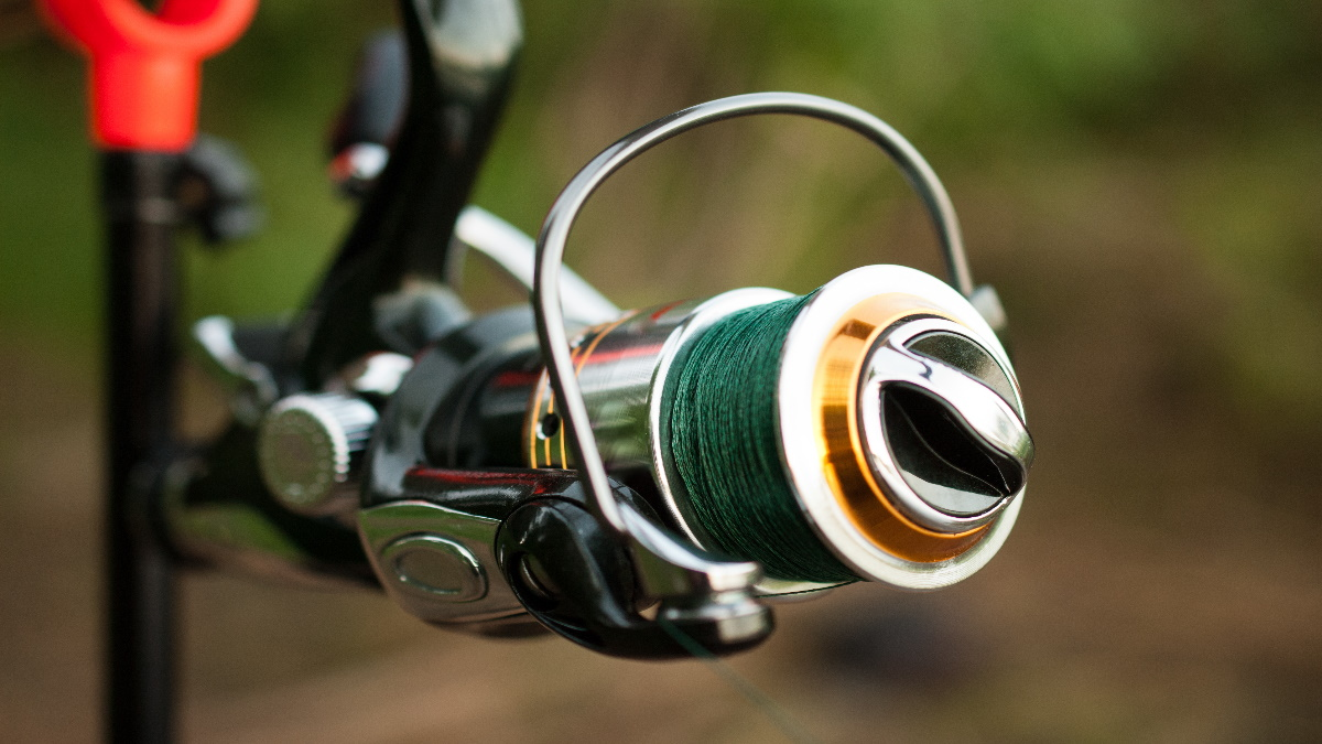 Spinning rod spooled up with green braided fishing line.