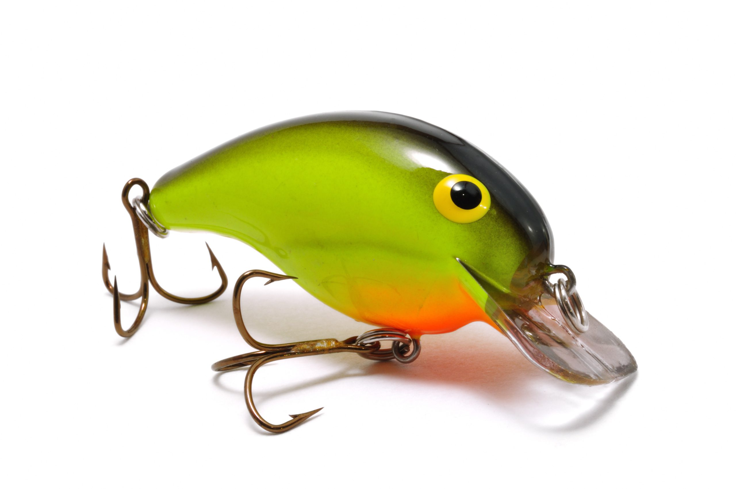 A yellow and black crankbait isolated on a white background.