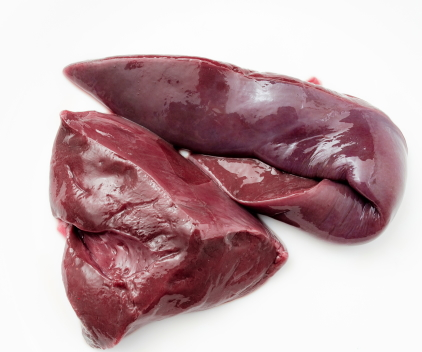 Sliced beef liver on a white background.